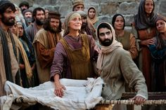 The widow of Nain looks at Jesus in gratitude after He has raised her son from the dead.
