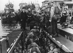 American troops with their equipment boarding a landing craft ready for embarkation to France. (Hulton Archive/Getty Images)