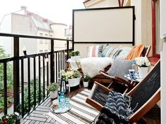 a small balcony transformed! the cozy furniture and deck tiles make it feel like so much more! #outdoors #patio