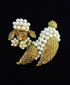 Offering a poodle brooch in gold tone with glass seed pearls and red rhinestones...vintage:  This is a darling textured poodle brooch encrusted with glass seed pearls on ... #figural #animal #rhinestones
