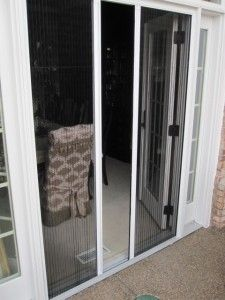 Double Plisse Retractable Screen Partially Open on Atrium Doorway - this is what I'll use with the french doors in my living room and kitchen when we replace the sliding ones