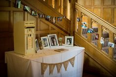 We love this shot from JD Photography of the signing book/card table. Pictures of the bride & groom around the bannisters and family Weddings on the table