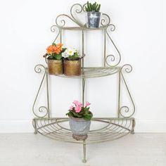 An antique style distressed green folding plant stand, ideal addition to garden, kitchen or conservatory to display your favourite plants all in one place. Alternatively this item could also be used as a storage stand for kitchen items such as pots and pans, a durable item with a multitude of uses. Displaying three tiers this item folds flat for ease of storage, complete with scrolls to the back frame and finished with a heart shape to the top of the piece. affiliate link for noths