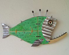 Fish made with Wood, Metal,Glass, Handmade by Unikos Arts Give your wall a upcycled beach steampunk theme with one of a kind original distressed Fish wall art sculpture. Wood Fish, Metal Fish, Ocean Crafts, Fish Crafts, Fish Wall Art, Fish Art, Fish Sculpture, Wall Sculptures, Steampunk Theme