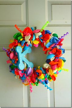 birthday wreath - get a letter for each member of the family and glue wire to each so they can switch it out...