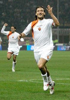Francesco Totti of AS Roma gestures as he celebrates a goal during the Serie A match between Inter Milan and AS Roma on October 26 2005 at the. Totti Francesco, Totti Roma, European Cup, As Roma, Italian Beauty, Liverpool, Rome, Milan, Running