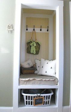 Small space mudroom uses entryway closet for storage  Maybe do this in one of the sides of our entryway closet?