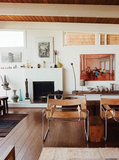 Beyond a pair of Wassily chairs, a James Weeks painting hangs above Native American art collected by June's late husband, Leroy, who was one of the original mechanical engineers of the Stanford Linear Accelerator.