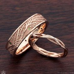 Tree of Life Wedding Band customized with green diamond accents in 14k rose gold and a matching 14k rose gold Embracing Tree Branch Wedding Band. Design your set in the styles, metals and stones you both love!