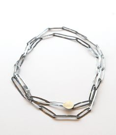 John Iversen irregular chain-link necklace with oxidized silver and 18k gold. Gallery Lulo.
