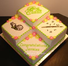 graduation cake in school colors top will say year, lft side will have ?, Rt side track, and bottom will say Congrats and their name