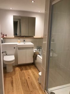 Bathroom with Hampshire flooring and tiles are BCT Brighton but ordered from Kahrs Flooring, Toilet And Sink Unit, Real Wood, Hampshire, Brighton, Tiles, Vanity, Cabinet, Bathroom