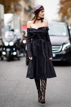 A guest wears a purple beret hat a black offshoulder dress outside Lanvin during Paris Fashion Week Womenswear Spring/Summer 2018 on September 27...