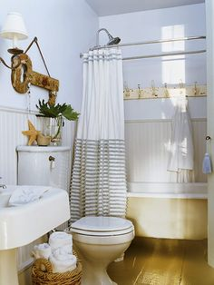 Free up space in your linen closet and bring towels within reach with baskets and hooks. Baskets are a perfect solution for storing towels when guests come over. (Photo: Photo: Tria Giovan)