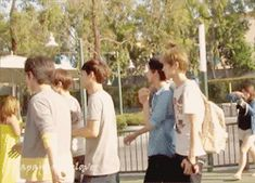 Disneyland Luhan hops over the post instead of letting go of his bro Sehun (GIF)