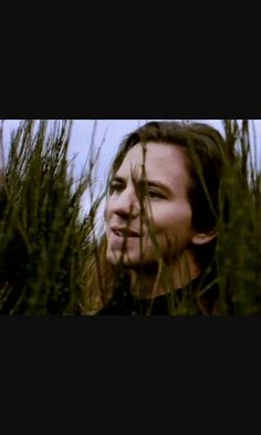 Eddie  Vedder. 'Hunger Strike' video, Temple of the Dog. The first time I'd seen him or heard him sing was in this video, that amazing voice coming out of the guy hiding in the tall grass.