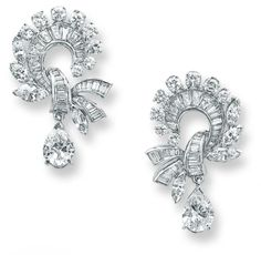 A pair of diamond earclips, 1960  Each designed as a stylised scrolling knot set with baguette-, marquise and circularcut diamonds, terminat...