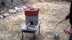 How to improve on the basic brick rocket stove ~ this is cheap, easy and works really well!  I can't wait to try it.