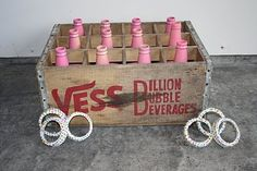 ring toss with mason jar rings & glass bottles in Camp Branch milk crate