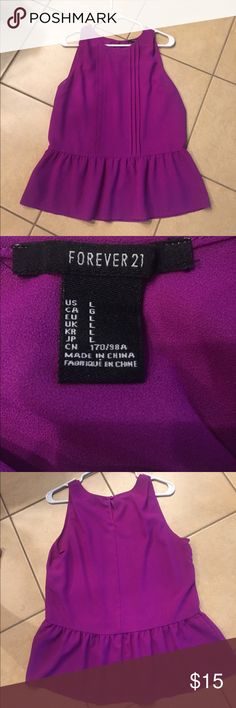 Purple peplum Forever 21 blouse Like new. Great with skinny capris for work with a sweater or blazer! Forever 21 size large purple blouse Forever 21 Tops Blouses