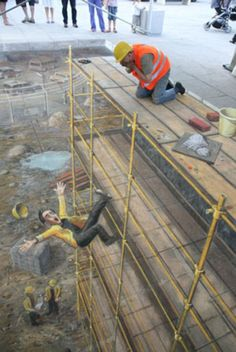 Fall guy: All the scaffolding and even the boards Julian Beever is kneeling on are drawn in challk in this photo from Vienna