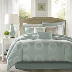 Update your room instantly with the Baxter Bedding Collection. Made from a polyester jacquard fabrication, the seafoam blue/green/ color is used as the base for the medallion motif that is spread out across the duvet cover and shams.