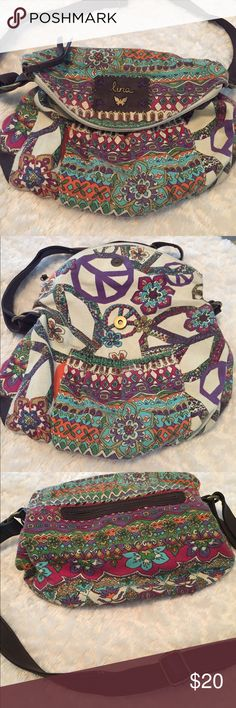 Lina BoHo Peace Handbag Like new, Lina bohemian style adjust strap shoulder bag/crossbody . Fun fabric of flowers and peace signs .Two outside pockets and one inside pocket . Fold over flap with zipper closure . Check out my closet , I offer discounts on bundles. Smoke free home. Lina Bags