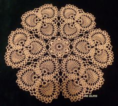 Pineapple Doily designed by Nadia Kukochkina, may 2014. Made with 6 triads of pineapples. Pattern included.