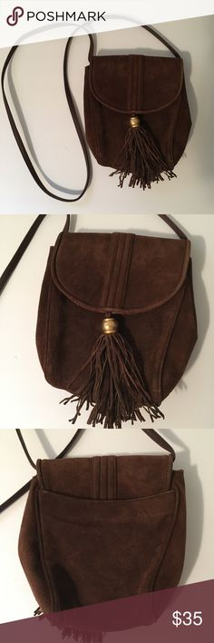 Vintage Architect Brown Suede Crossbody Purse Vintage Architect Crossbody Purse made of a brown suede like material. The purse features a tassel and gold bead detail and has a snap closure. Architect Bags Crossbody Bags