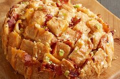 Made with a round sourdough bread loaf, these Cheesy Bread Pulls are a neat way to present friends and family with garlicky, bacon-studded goodness.