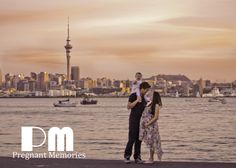 Couple, maternity photography overlooking Auckland skyline  Photography by: Rikki-Lee Wrightson WOW Imagery & Graphic Design... Maybe the London skyline