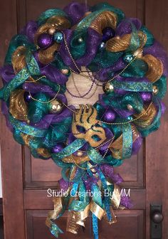 One of the classier ones I've seen! Gorgeous!   Mardi Gras Wreath, Festival Wreath, Peacock Wreath, Party Wreath, Masquerade Party, Mardi Gras Decoration by StudioCreationsByMM on Etsy https://www.etsy.com/listing/538870820/mardi-gras-wreath-festival-wreath
