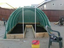 Nearly done with the greenhouse...made of pvc pipe  sun screen netting.