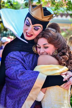 The Evil Queen from Snow White and the Seven Dwarfs with Belle from Beauty and the Beast