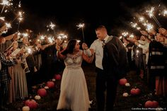 Sparkler exit with pumpkins lining the aisle