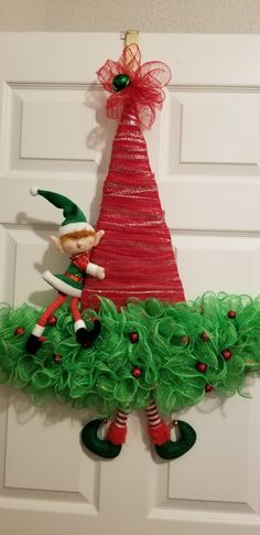 Using a Dollar Tree witch hat metal frame, I created an Elf Wreath for Christmas. Christmas Elf, Christmas Ornaments, Metal Christmas Tree, Dollar Tree Christmas, Christmas Mesh Wreaths, Christmas Lanterns, Dollar Tree Crafts, Christmas Poinsettia, Holiday Wreaths