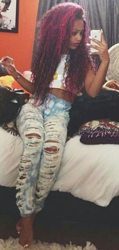 ripped to hell light wash jeans, crop top & purple dyed curly hair. she is completely adorable.