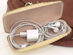 What a great idea for storing earphones and other small leads/cables - an old glasses case!