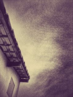 A roof of a house in black and white