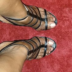 BEAUTIFUL STRAPPY SANDALS Beautiful black patent leather strappy sandals with a 4 inch heel.  I've love these sandals and hate to part with them.   I guess by gaining some weight my feet got bigger:)  they are in good condition,  no scuffs or scratches. ... Marc Fisher Shoes Sandals