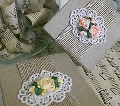 Silk ribbon embroidered roses on lace & burlap boxes. http://caffeinatedkitten.wix.com/crafts