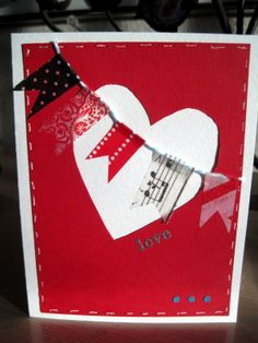 Valentine card for 2014: Washi tape and baker's twine banner across a large heart. Inspired by Pinterest.
