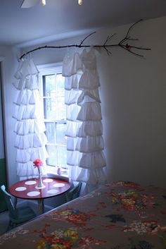 Great idea for a curtain rod. They even put a cardinal on the branch! I bet a cute little faerie swing would look awesome!!! - Primitive and Proper