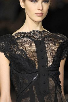 Love the lace, the detailing and the styling - so demurely sexy.