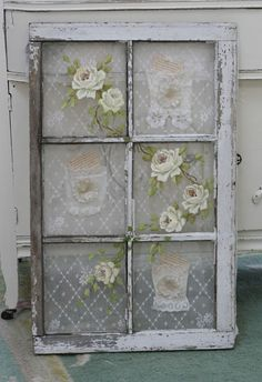 Delicate lace and roses make an old window beautiful.
