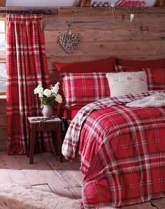 Introduce a rustic Highland look to the bedroom with tartan textiles and wood panelling.
