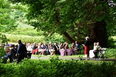 Wedding ceremony outside a castle in the woods