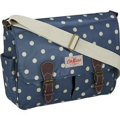 Our saddle bags are something of a staple with their practical design and plentiful pockets. Made using our durable oilcloth and completed with leather trims, they are easy to care for and their adjustable strap means they can be used as a shoulder or cross body bag. This design features our popular Spot print in a pretty petrol blue colour.