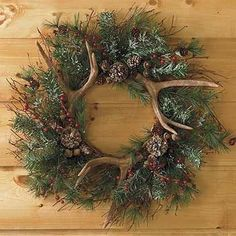 """Wreath Evergreen w/ Antlers.   24""""  - great use of his extra antlers!"""
