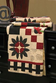 Abloomin' Garden - From Quiltmaker magazine.  Like the border and colors on this quilt